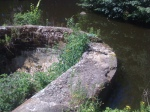 An old piece of the canal works jutting out into the Blackstone Canal.